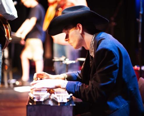 Image of Dakota Holden playing a pedal steel guitar